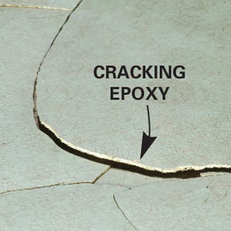 <b>Peeling epoxy</b></br> Too much moisture causes epoxy paint to crack and pop off.