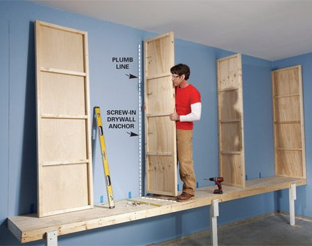 <b>Photo 2: Attach uprights</b></br> Fasten the uprights to the wall with screw-in drywall anchors. Make sure each upright is plumb and squared with the base.