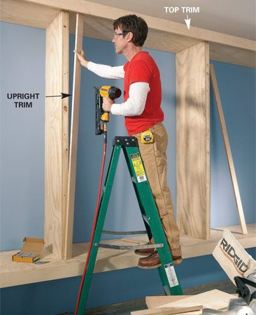 <b>Photo 4: Nail on trim</b><br/>Dress up the front edges of the base and uprights by nailing on trim boards. The top trim overhangs the top to hide the door track.