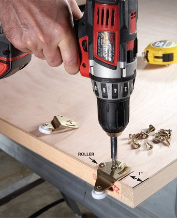 <b>Photo 6: Attach rollers to doors</b></br> Screw two rollers to the back of each door. Later, you can loosen the screws to raise or lower the door for a perfect fit.
