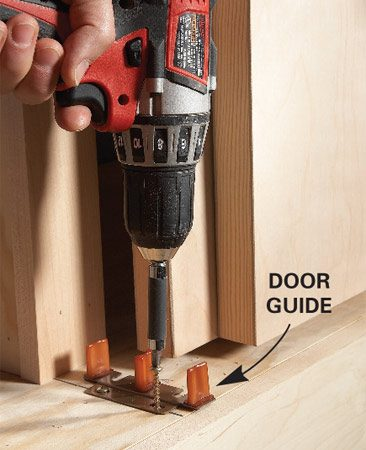 <b>Door guides</b></br> Install door guides at each upright and halfway between them.