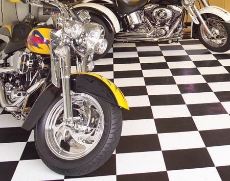 <b>Rigid tiles</b></br> Rigid snap-together tiles stand up to floor jacks and kickstands.