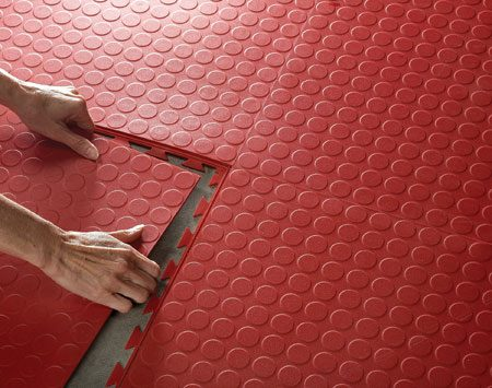 <b>Flexible tile installation</b></br> Interlocking flexible tiles are slip resistant and soft underfoot.
