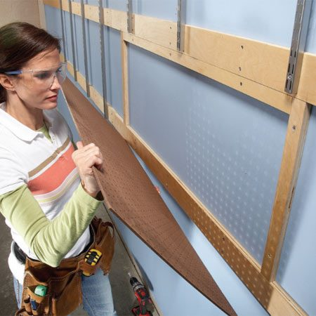 <b>Photo 4: Pegboard</b></br> Add a section of pegboard. Frame the edges with wood strips and fasten all four sides of the pegboard.