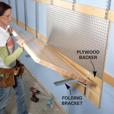 <b>Photo 5: Workbench</b><br/>Mount heavy-duty folding brackets on a 3/4-in. plywood backer to create a fold-down workbench.