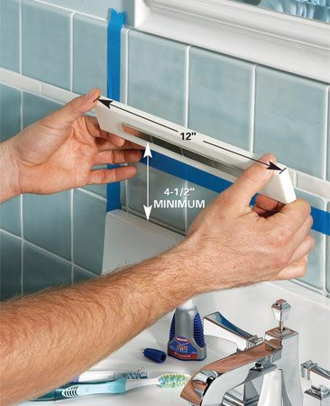 <b>Photo 2: Mount the holder</b></br> Glue the mounting strip to the wall with Super Glue, hot-melt glue or silicone caulk.