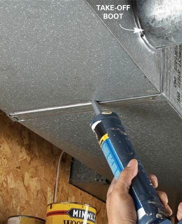 <b>Photo 1: Caulk</b></br> Apply a bead of silicone caulk along both edges of the duct joint.