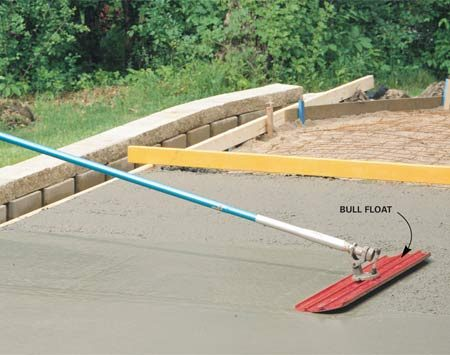 <b>Bull float in action</b></br> Use a bull float to flatten large areas immediately after placing the concrete.