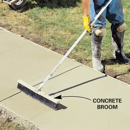 <b>Broom the finish</b></br> A stiff broom creates a slightly roughened concrete surface.