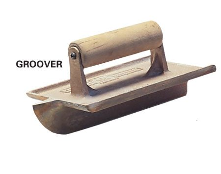 <b>Close-up of groover</b></br> A groover has a blade (typically 1-in.) on the underside that cuts the groove.