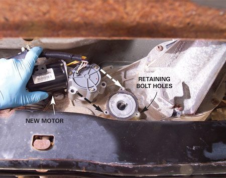 <b>Photo 1: Change motors</b></br> Remove the old shift motor and move the new motor into place so it slides onto the shaft. Install the retaining bolts.