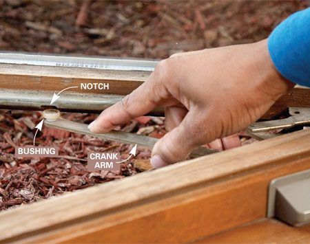 <b>Photo 1: Pop out the crank arm</b></br> Open the window until the crank arm bushing is aligned with the guide track notch. Push down on the arm to pop the bushing out of the track.