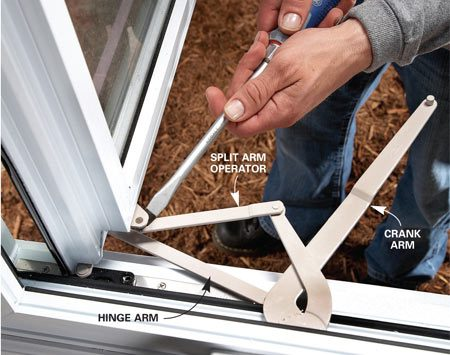 <b>Photo 1: Disconnect the arms</b></br> Open the sash and disconnect the crank arm. Pry the split arm operator off the top and the bottom of the sash with a screwdriver (the hinge arms easily pop off).