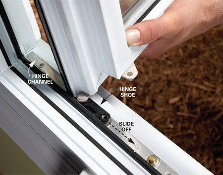 <b>Photo 2: Slide the hinge shoe out</b></br> Slide the hinge shoes out of the hinge channels at the top and bottom of the window to remove the sash.