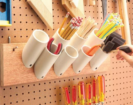 <b>Cut PVC into short pieces and mount  on pegboard</b></br> Short PVC pieces keep things organized