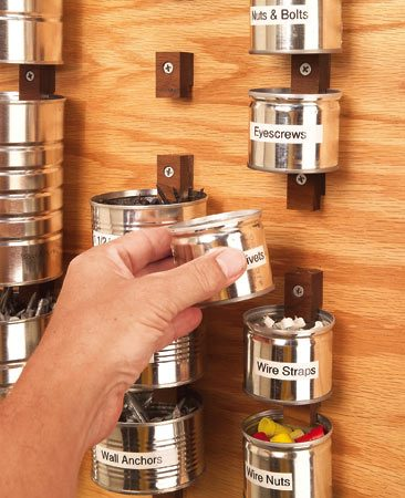<b>Screw wood clips to plywood and put cans to work.</b></br> Recycled cans make great hardware holders
