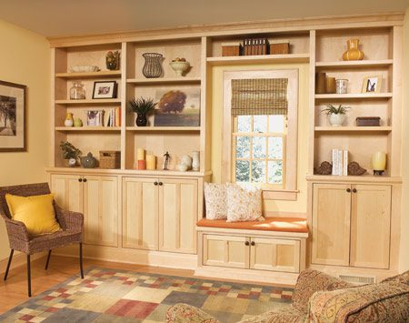 <b>Standard kitchen cabinets make it easy</b></br> Building and hanging cabinet doors is a fussy, time-consuming job. To avoid the hassle, buy standard kitchen cabinets and build around them. The inexpensive cabinets we chose for this bookcase cost about $150 more than building doors and boxes from scratch. Considering the huge time savings, that's a bargain. The main disadvantage of store-bought cabinets is that almost all are prefinished. So you'll have to find a matching stain and clear coating to finish the parts you've built from scratch.