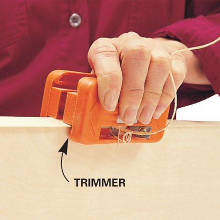 "<b>Trim with a special edge band trimmer</b></br> You can trim with a utility knife, but that requires a steady hand, and any wrong move creates a wavy edge. An edge band trimmer ($20) eliminates mistakes and does the job much faster. To buy one online, search for ""edge band trimmer."" Complete edge-banding instructions <a href='http://www.familyhandyman.com/DIY-Tools---Tips/DIY-Skills/Woodworking-Skills/edge-banding-with-iron-on-veneer-edging'>here</a>."