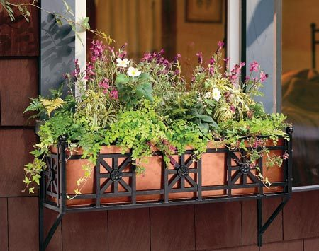 <b>Mount a window box below double-hung, slide-by or stationary windows.</b></br> Build your own window box or buy one from a garden center
