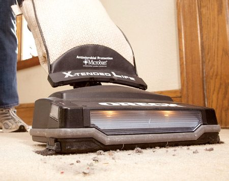 <b>Set the vacuum at the right height</b><br/>If your vacuum is set too low, you can damage the carpet as well as the vacuum's roller brush and drive belt. If it's set too high, you won't pick up any dirt. To set the vacuum's ideal height, raise it to its highest setting, turn it on and lower it until you can feel the vacuum trying to tug itself forward.