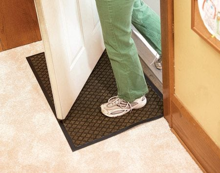 <b>Use mats inside and outside</b><br/>Use water absorbent mats indoors to wick off moisture before the carpet does.
