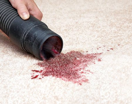 <b>Use a shop vacuum on wet spills</b></br> Keep vacuuming until no more liquid can be removed. If the spill was a colored liquid, treat it as you would a stain, after vacuuming.