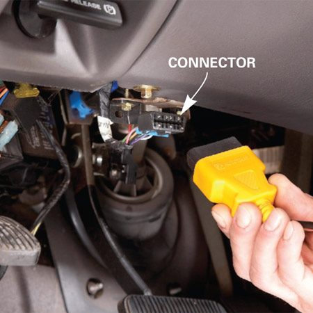<b>Photo 1: Plug in</b></br> Plug your code reader into the diagnostic link connector under the dash (engine off). Then start the vehicle and follow the code reading procedure in the instruction manual.