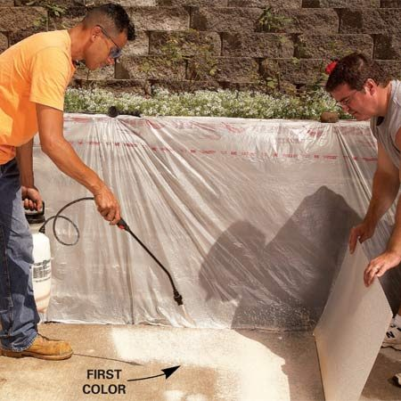 <b>Photo 3: Base coat</b></br> A base coat of stain covers the concrete and makes your topcoat color more vibrant. Spray the first color (the base coat) onto wet concrete, applying just enough stain to cover the surface. Move the sprayer wand in a continuous circular motion.