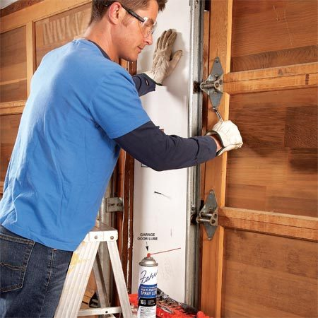 <b>Photo 1: Tighten all parts</b></br> Snug up all the nuts and bolts on your garage door and check for worn parts and replace where needed. Then spray all the moving components with garage door lubricant.
