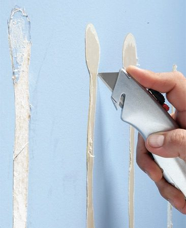<b>Cut out old glue strips</b></br> Score the paper with a utility knife, then strip off the old glue.