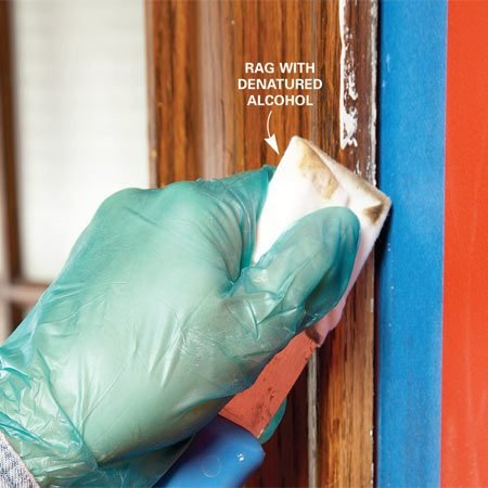 <b>Photo 1: Remove old paint spots</b></br> Soften old paint along the edges of trim with alcohol. A rag wrapped around a putty knife lets you scrub the trim without slopping alcohol onto the wall.