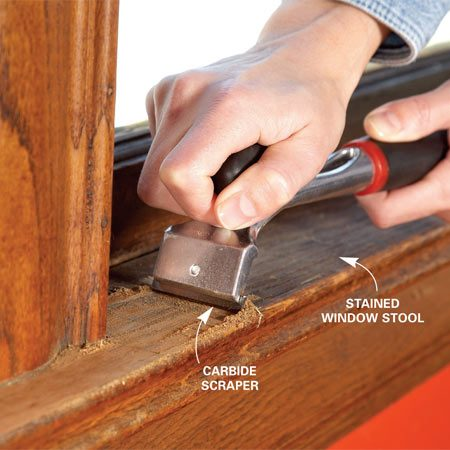 <b>Photo 2: Scrape eroded areas</b></br> Scrape away badly weathered finish. A carbide paint scraper removes the old finish much faster than sandpaper. But be careful not to gouge the wood.