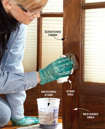 <b>Photo 7: Apply matching stain</b></br> Hide scratches, chips and worn away finish with a fresh dose of stain. Then wipe the woodwork with a clean rag to remove the excess stain. Let the stain dry overnight.