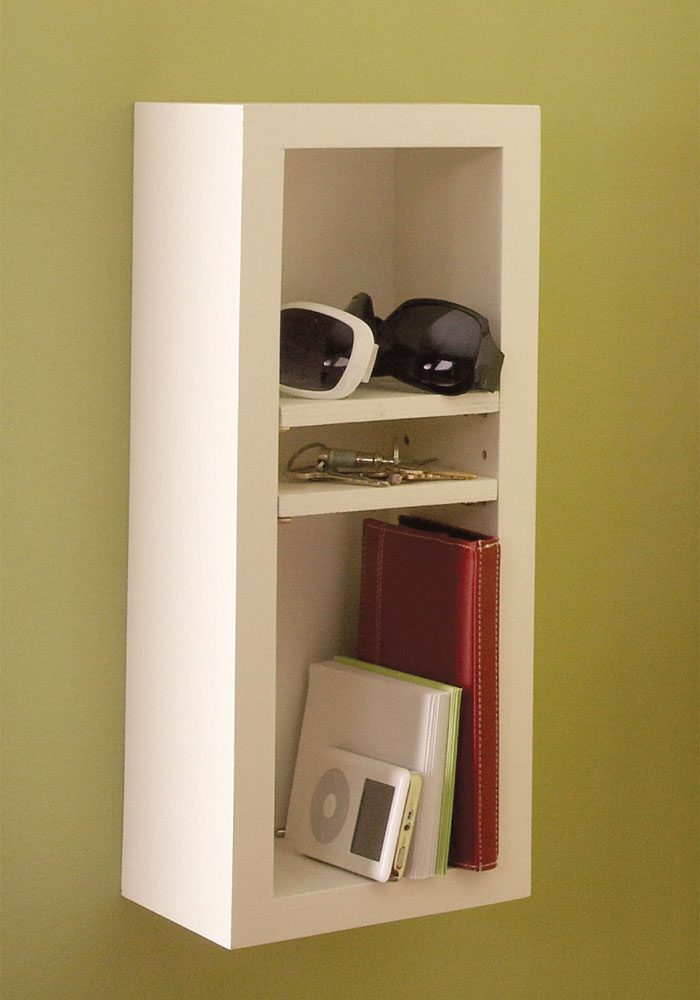 Add peg holes for an adjustable shelf.