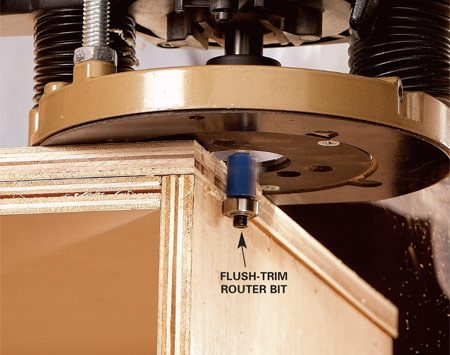 <b>Photo 4: Trim the edges flush</b></br> Trim the overhanging plywood with a flush-trim router bit. The bit leaves a straight, smooth cut that's perfectly flush at the ends. Install the end panels using the same method.