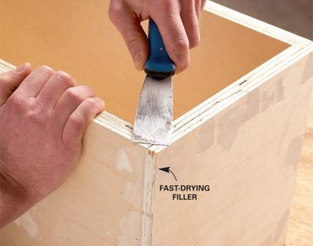 <b>Photo 5: Fill gaps and holes</b><br/>Fill the plywood edges as well as nail holes and dents. Use a fast-drying filler so you can sand the patches right away.