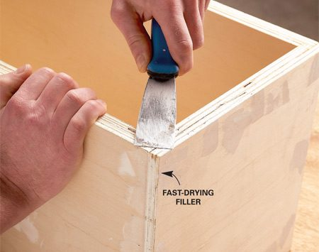 <b>Photo 5: Fill gaps and holes</b></br> Fill the plywood edges as well as nail holes and dents. Use a fast-drying filler so you can sand the patches right away.