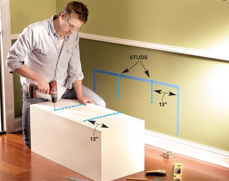 <b>Photo 7: Locate wall studs</b></br> Outline the box location on the wall and mark the wall studs. Use the outline to mark the pilot holes and then drill them through the back of the box.