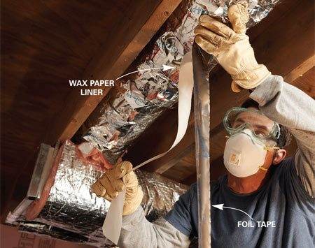 <b>Photo 4: Wrap round ducts also</b></br> Repeat the cutting, tabbing and taping procedure for each round duct.
