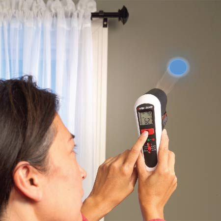 <b>Find cold spots</b></br> Point the Infrared thermometer at windows, walls and ceilings. In the model shown here, when the detector finds a cold or warm spot, the LED light changes from green to red (for warm) or blue (for cold).