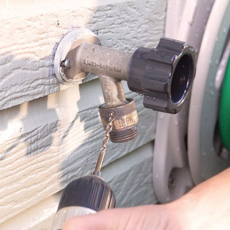 "<b>Photo 1: Drill out the set screw</b></br> Drill a small ""starter"" hole next to the setscrew. Switch to a larger drill bit and drill at an angle toward the setscrew. Remove the old vacuum breaker."
