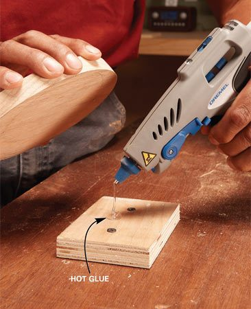 <b>Glue-down trick</b><br/>Here's a nifty trick for securing small pieces while you rout them. Start by screwing a scrap of wood to the workbench to elevate your project and provide clearance for the bearing. The scrap should be smaller than the piece you're routing. Then apply 1/2 teaspoon of hot-melt glue to the scrap and stick your workpiece to it. Allow it to cool a few minutes before you rout the edge. When you're done, just twist the routed piece to break it free. Then scrape off the hot-melt glue with a chisel or putty knife.