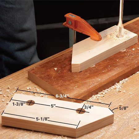 <b>Photo 1: Drill dowel holes</b></br> Clamp the 1x3 support to a piece of scrap wood as you drill the holes to prevent the wood from splintering.