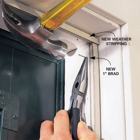 <b>Photo 3: Attach new weather stripping</b></br> Cut the new weather stripping to length and reinstall it, pinning it with new brads positioned near the old ones.