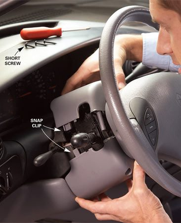 <b>Photo 1: Take off the cover</b></br> Remove the screws from the bottom half of the steering column cover and note the length, thread style and location of each screw. They have to go back in the same place. Disengage the plastic snap clips and separate the two halves of the steering column cover.