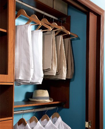 <b>Hang pants above shirts</b></br> It may feel topsy-turvy, but hanging folded pants above shirts and coats makes everything easier to see.
