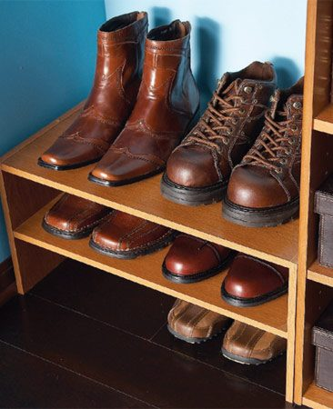 <b>Use shoe shelves, not cubbies</b></br> It's hard to fit a pair of shoes into narrow cubbies (especially men's shoes). Open shelf organizers allow air to circulate and also make better use of the available floor space below the long hanging section of clothes.
