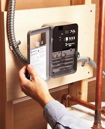 <b>Photo 1: Water heater timer</b></br> A timer turns on the water heater only when you need it, so you don't waste electricity heating and reheating water that sits in the tank.