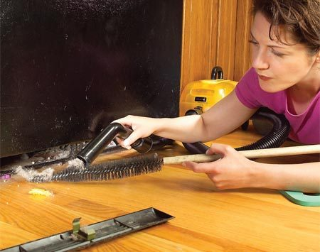 <b>Clean coils</b></br> Brush and vacuum the coils at the bottom or the back of the refrigerator. A coil cleaning brush (available at appliance parts stores or home centers) is bendable to fit in tight areas.
