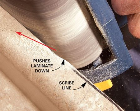 <b>Perfect for scribing</b></br> <p>A common use   for a small belt   sander is scribing.   You can gradually   sneak up on a   curved line for a   perfect fit. On a   laminate countertop,   make sure the   direction of belt   travel pushes the   laminate down.</p>